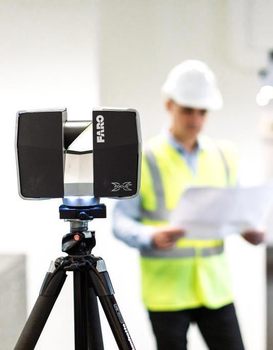 Surveyor completing measured survey in office